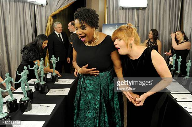 Actresses Adrienne C Moore and Annie Golden pose in the trophy room at TNT's 21st Annual Screen Actors Guild Awards at The Shrine Auditorium on...