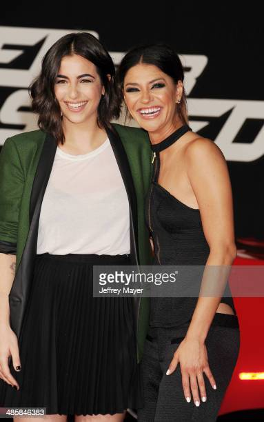 Actresses Alanna Masterson and Jessica Szohr arrive at the Los Angeles premiere of 'Need For Speed' at TCL Chinese Theatre on March 6 2014 in...