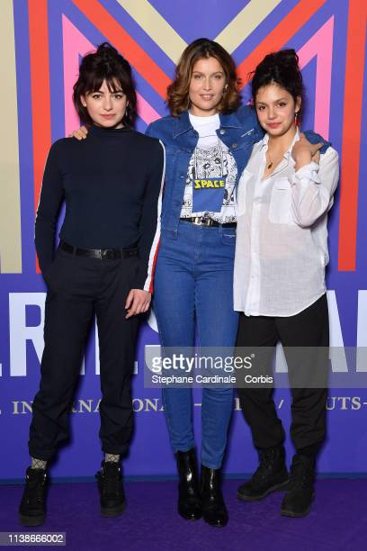 Actresses Alba Gaia Bellugi Laetitia Casta and Noee Abita attend the Une Ile Photocall during the 2nd Series Mania Festival on March 27 2019 in Lille...