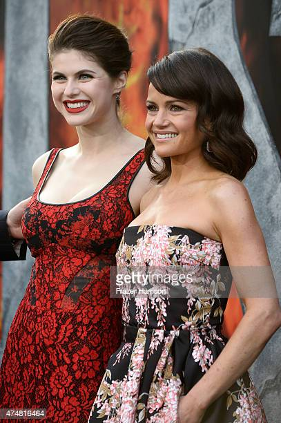 Actresses Alexandra Daddario and Carla Gugino attend the premiere of Warner Bros Pictures' 'San Andreas' at the TCL Chinese Theatre on May 26 2015 in...