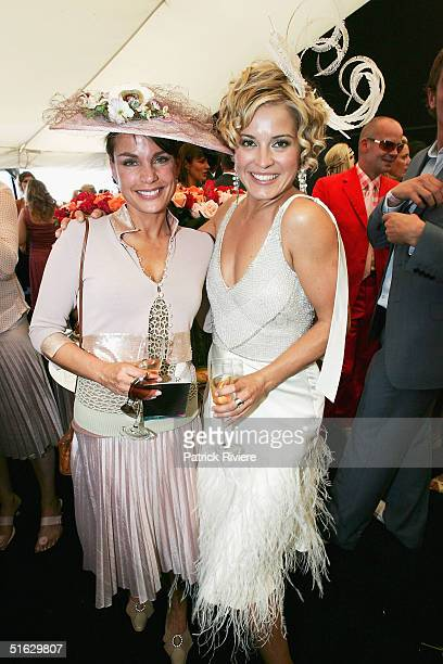 Actresses Alexandra Davies and Sigrid Thornton attend the Melbourne Cup Carnival's Derby Day in the Moet et Chandon marquee at Flemington October 30...