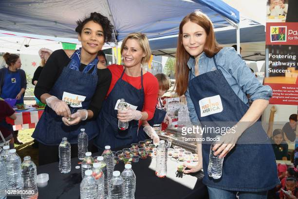 Actresses Alexandra Shipp Julie Bowen and Darby Stanchfield attend Celebrity Friends Volunteer with Feeding America at Para Los Niños' Felices...