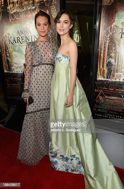 Actresses Alicia Vikander and Keira Knightley attend the premiere of Focus Features' 'Anna Karenina' held at ArcLight Cinemas on November 14 2012 in...