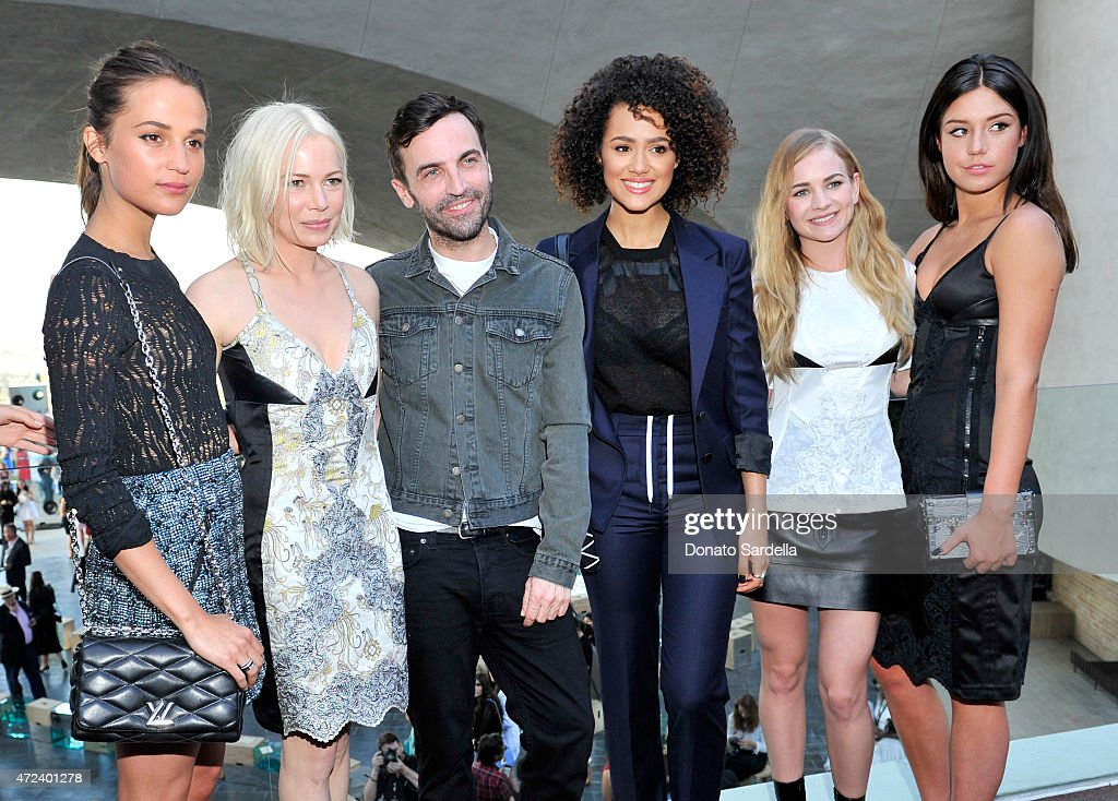 Actresses Alicia Vikander and Michelle Williams, designer Nicolas Ghesquiere and actresses Nathalie Emmanuel, Britt Robertson, and Adèle Exarchopoulos backstage at the Louis Vuitton Cruise 2016 Resort Collection shown at a private residence on May 6, 2015 in Palm Springs, California.