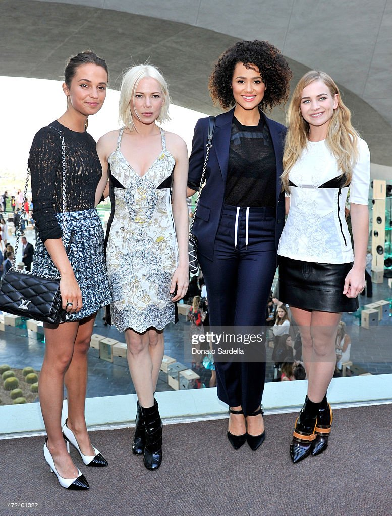 Actresses Alicia Vikander and Michelle Williams, Nathalie Emmanuel, and Britt Robertson backstage at the Louis Vuitton Cruise 2016 Resort Collection shown at a private residence on May 6, 2015 in Palm Springs, California.