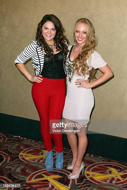 Actresses Alisha Mullally and Danielle Chuchran arrive for the sneak preview of 12 Dogs Of Christmas Great Puppy Rescue on October 4 2012 in Los...