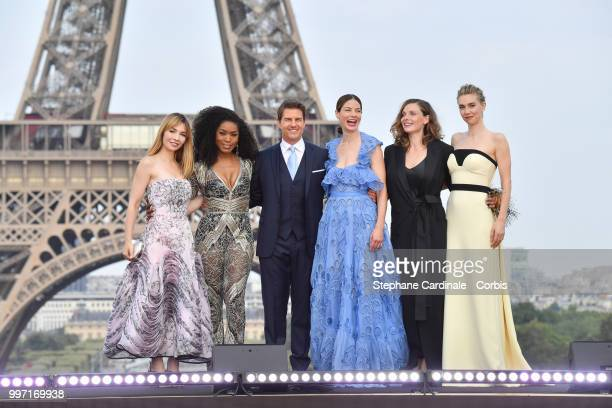 Actresses Alix Benezech Angela Bassett Actor and Producer Tom Cruise Actresses Michelle Monaghan Rebecca Ferguson and Vanessa Kirby pose in front of...