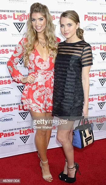 Actresses Allie DeBerry and Anne Winters arrive at the premiere of 'Pass The Light' at ArcLight Cinemas on February 2 2015 in Hollywood California
