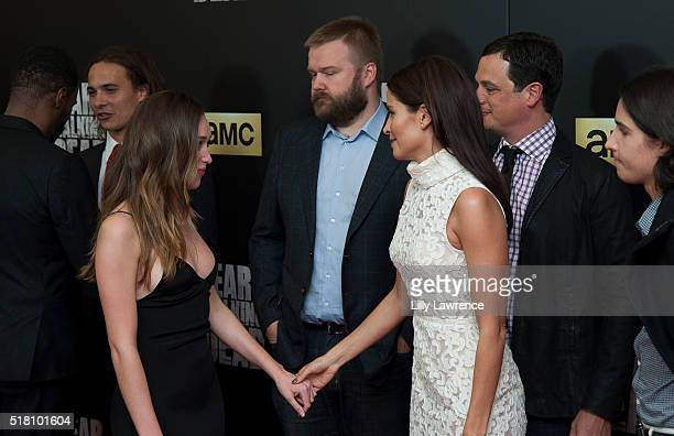 Actresses Alycia DebnamCarey and Mercedes Masohn greet each other at the premiere of AMC's 'Fear The Walking Dead' Season 2 at Cinemark Playa Vista...