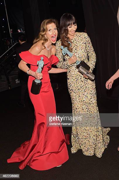 Actresses Alysia Reiner and Jackie Cruz winners of the Outstanding Performance by an Ensemble in a Comedy Series for 'Orange Is the New Black' attend...