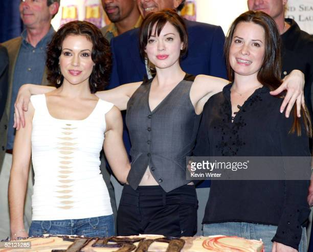 Actresses Alyssa Milano Rose McGowan and Holly Marie Combs celebrate the WB's 'Charmed' 150th episode cake cutting on the set at Paramount Studios on...
