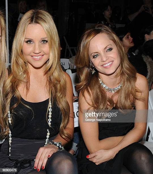 Actresses Amanda Bynes and Mena Suvari attend the Ann Taylor See Now Wear Now runway show at The New York Public Library on September 17 2009 in New...