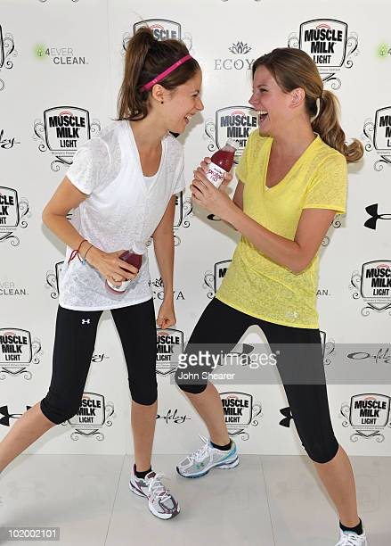Actresses Amanda Crew and Amber Borycki attend the 'Muscle Milk Light' Women's Fitness Retreat on June 11 2010 in Beverly Hills California
