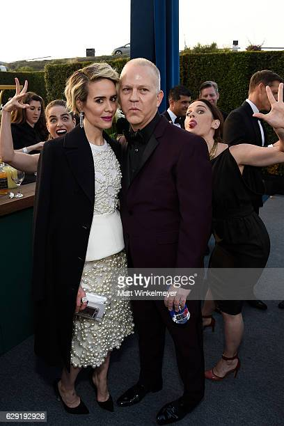 Actresses Amanda Peet and Robin Tunney photobomb actress Sarah Paulson and producer Ryan Murphy during The 22nd Annual Critics' Choice Awards at...