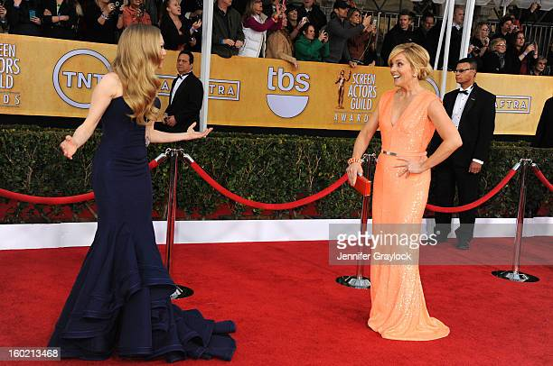 Actresses Amanda Seyfried and Jane Krakowski arrive at the 19th Annual Screen Actors Guild Awards held at The Shrine Auditorium on January 27 2013 in...