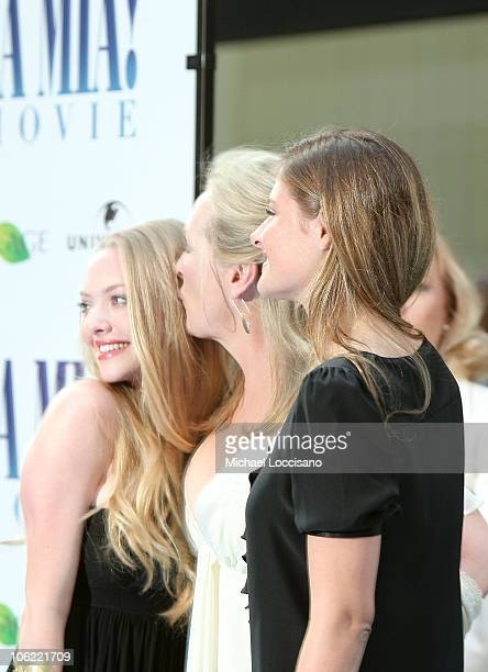 Actresses Amanda Seyfried and Meryl Streep with daughter Louisa Gummer attend the premiere of Mamma Mia at the Ziegfeld Theatre on July 16 2008 in...