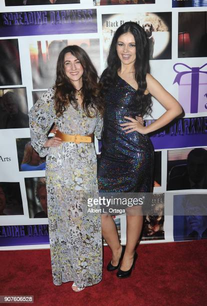 Actresses Amber Martinez and Natasha Blasick arrive for the Premiere Of 'Spreading Darkness' held at Ray Stark Family Theatre on January 19 2018 in...