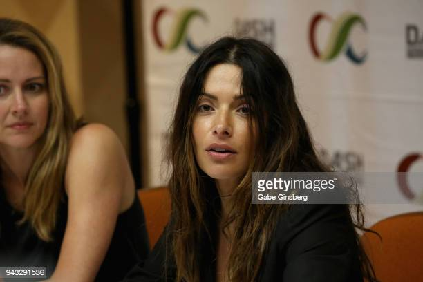 Actresses Amy Acker and Sarah Shahi speak to interviewers during the ClexaCon 2018 convention at the Tropicana Las Vegas on April 7 2018 in Las Vegas...