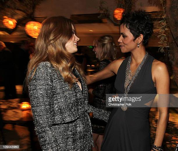 Actresses Amy Adams and Halle Berry attend the Fourth Annual Women In Film PreOscar Cocktail Party Presented by PerrierJouet at Soho House on...
