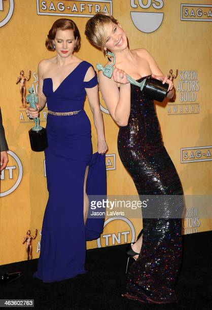 Actresses Amy Adams and Jennifer Lawrence pose in the press room at the 20th annual Screen Actors Guild Awards at The Shrine Auditorium on January 18...