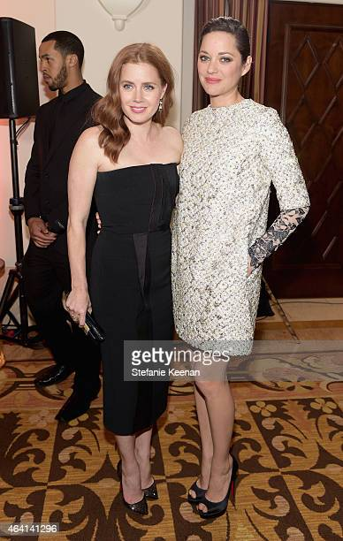 Actresses Amy Adams and Marion Cotillard attend The Weinstein Company's Academy Awards Nominees Dinner in partnership with Chopard DeLeon Tequila...