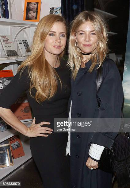 Actresses Amy Adams and Sienna Miller attend the screening of Paramount Pictures' 'Arrival' hosted by Spike Jonze and The Cinema Society at The...