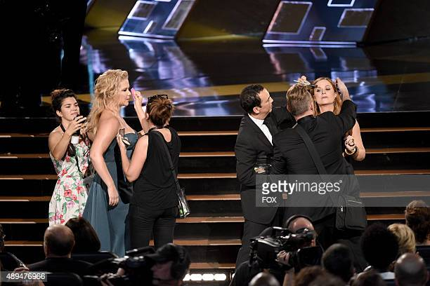 Actresses Amy Poehler and Amy Schumer get ready to present the Outstanding Supporting Actress in a Drama Series Award during the 67th Annual...
