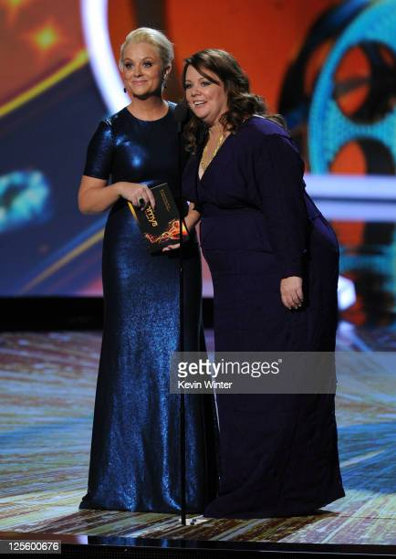 Actresses Amy Poehler and Melissa McCarthy speak onstage during the 63rd Annual Primetime Emmy Awards held at Nokia Theatre LA LIVE on September 18...