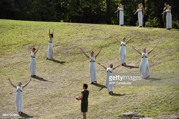 Actresses and actors perform at the Temple of Hera in Olympia the sanctuary where the Olympic Games were born in 776 BC on October 24 2017 during the...