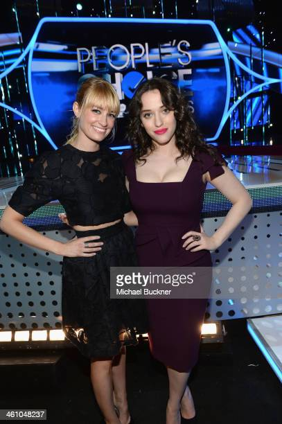 Actresses and People's Choice Awards hosts Beth Behrs and Kat Dennings pose in front of the stage for the 2014 People's Choice Awards at Nokia...