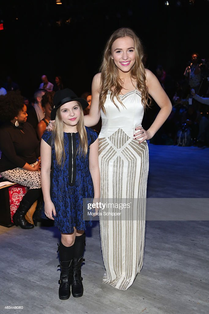 Actresses and singers Maisy Stella (L) and Lennon Stella attend the Idan Cohen fashion show during Mercedes-Benz Fashion Week Fall 2015 at The Pavilion at Lincoln Center on February 14, 2015 in New York City.