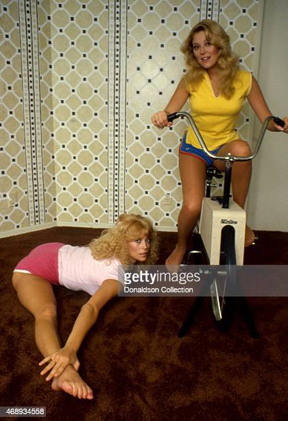 Actresses and sisters Audrey Landers and Judy Landers workout at home in circa 1986 in Los Angeles California