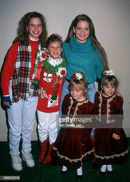 Actresses Andrea Barber Jodie Sweetin Candace Cameron Ashley Olsen and Mary Kate Olsen attending 60th Annual Hollywood Christmas Parade on December 1...