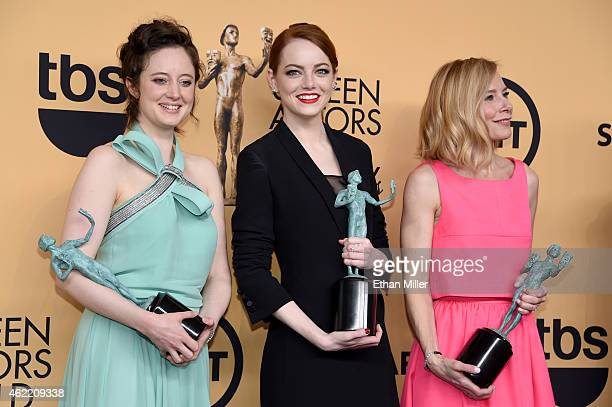 Actresses Andrea Riseborough Emma Stone and Amy Ryan winners of Outstanding Performance by a Cast in a Motion Picture for 'Birdman' pose in the press...