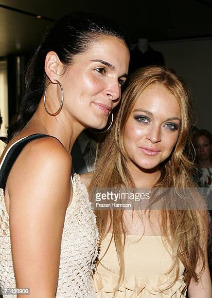 Actresses Angie Harmon and Lindsay Lohan attend the opening of Waist Down Skirts By Miuccia Prada held at Prada on July 13 2006 in Beverly Hills...