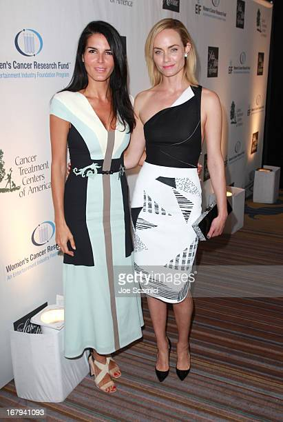 """Actresses Angie Harmon in Carolina Herrera and Amber Valletta attends EIF Women's Cancer Research Fund's 16th Annual """"An Unforgettable Evening""""..."""