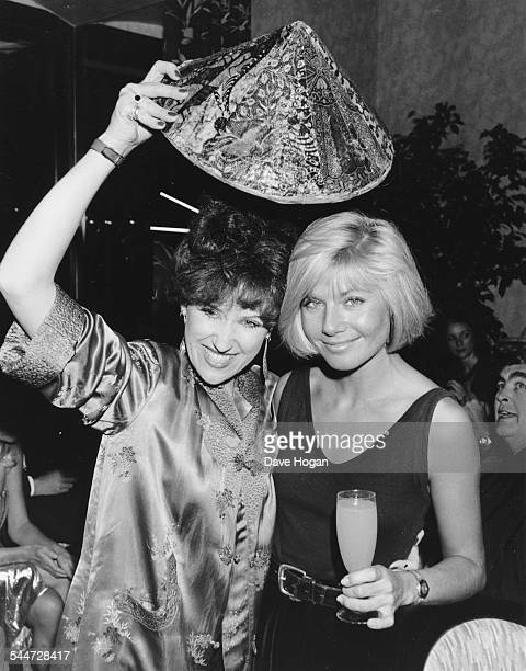 Actresses Anita Dobson and Glynis Barber joking around at the opening of a new Chinese restaurant in London, October 28th 1986.