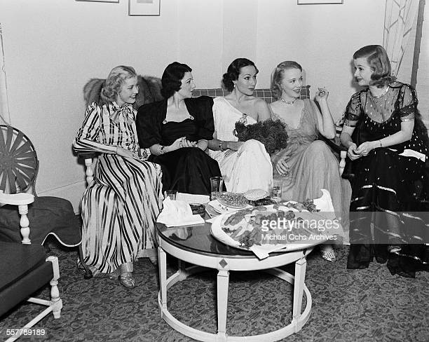 actresses Anita Louise Edith Wilkerson Dolores del Rio Virginia Bruce and Joan Bennett gather at a party in Los Angeles California