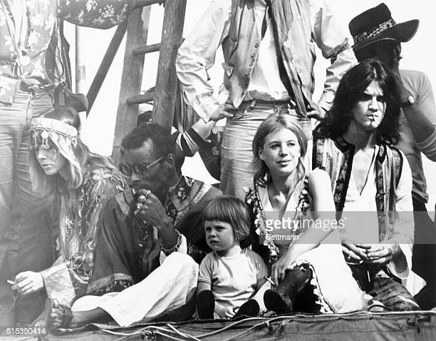 Actresses Anita Pallenberg and Marianne Faithfull with her son Nicholas are among the fans atop the Rolling Stones platform during the open air free...