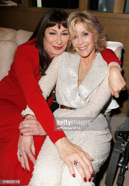 Actresses Anjelica Huston and Jane Fonda attend the 2014 Vanity Fair Oscar Party Hosted By Graydon Carter on March 2 2014 in West Hollywood California