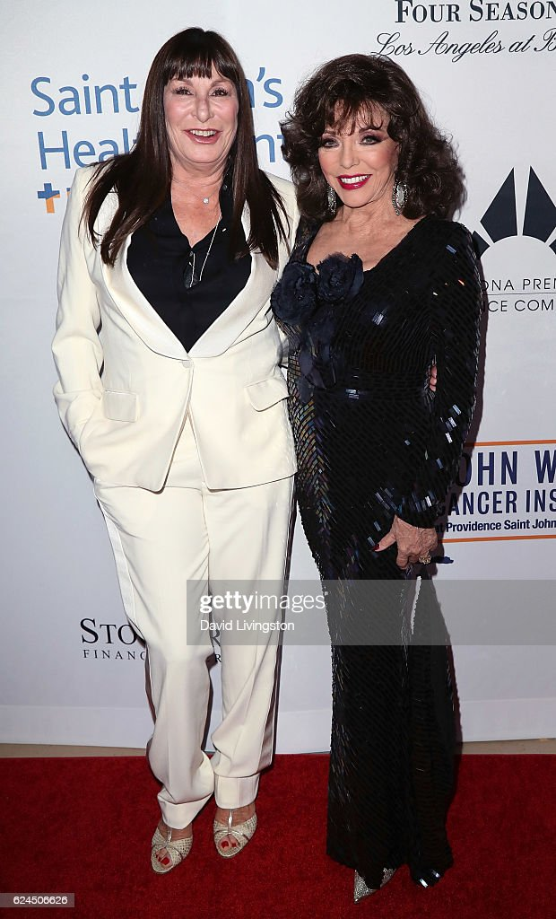 Actresses Anjelica Huston (L) and Joan Collins attend the Talk of the Town Gala 2016 at The Beverly Hilton Hotel on November 19, 2016 in Beverly Hills, California.