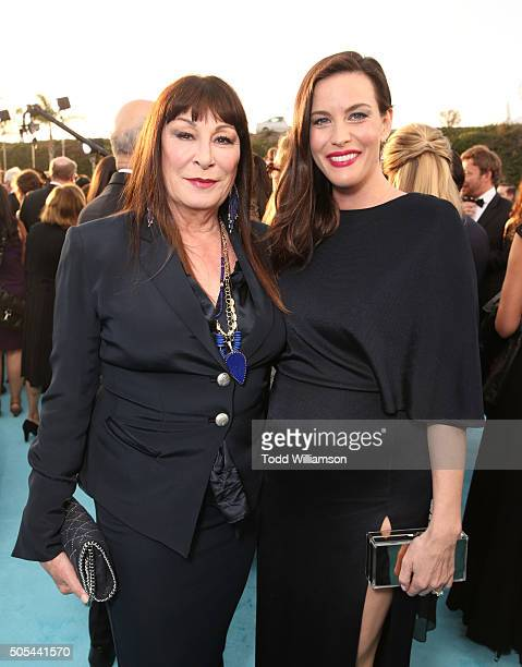 Actresses Anjelica Huston and Liv Tyler attend the 21st Annual Critics' Choice Awards at Barker Hangar on January 17 2016 in Santa Monica California