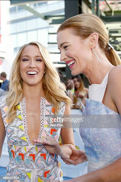 Actresses Anna Camp and Bridget Regan attend The 2015 MTV Movie Awards at Nokia Theatre LA Live on April 12 2015 in Los Angeles California