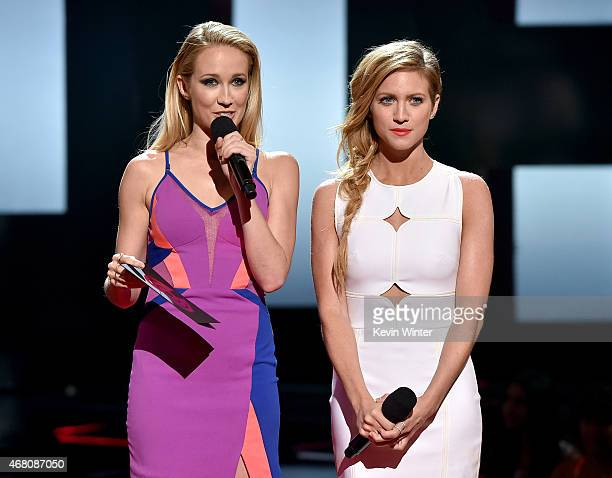 Actresses Anna Camp and Brittany Snow speak onstage during the 2015 iHeartRadio Music Awards which broadcasted live on NBC from The Shrine Auditorium...