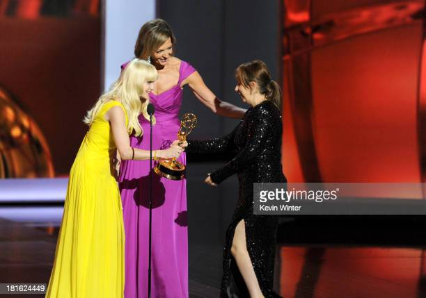Actresses Anna Faris and Allison Janney present the award to Abi Morgan winner for Best Writing for a Miniseries/Movie onstage during the 65th Annual...