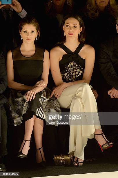Actresses Anna Kendrick and Emmy Rossum attend the Carolina Herrera fashion show during MercedesBenz Fashion Week Fall 2014 at The Theatre at Lincoln...