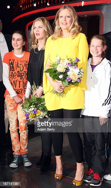 Actresses Anna Loos and Barbara Schoeneberger pose with child contestants at a photo call for the Das Erste television network program 'Klein Gegen...
