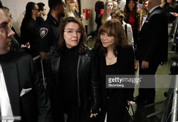 Actresses Annabella Sciorra left and Rosie Perez exit from state supreme court in New York US on Wednesday March 11 2020 Harvey Weinsteinwas...