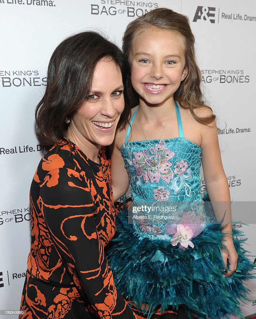 Actresses Annabeth Gish and Caitlin Carmichael attend A&E's premiere party event for Stephen King's 'Bag of Bones' at Fig & Olive Melrose Place on December 8, 2011 in West Hollywood, California.