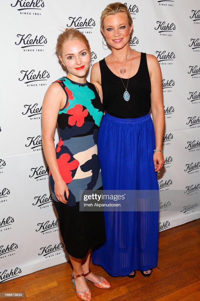 Actresses AnnaSophia Robb (L) and Amy Smart attend Kiehl's launch of an Environmental Partnership Benefiting Recycle Across America at Kiehl's Since 1851 Santa Monica Store on April 17, 2013 in Santa Monica, California.